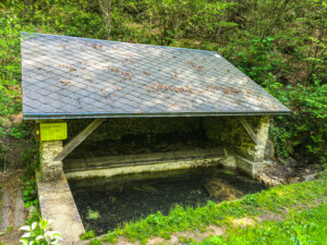 Lavoir de la Source aux Fées, an ancient wash house (translated as Fairies' Source).