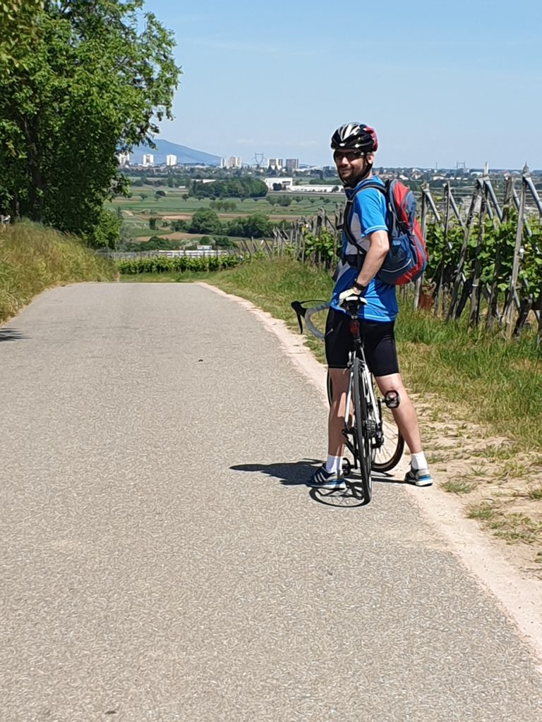 Road & Bike Trip: My tour guide and driver. Cycling towards Colmar.