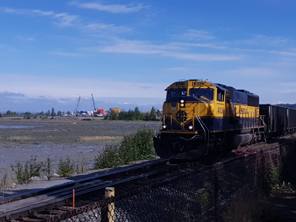 Alaska Railroad train running along Tony Knowles Coastal Trail